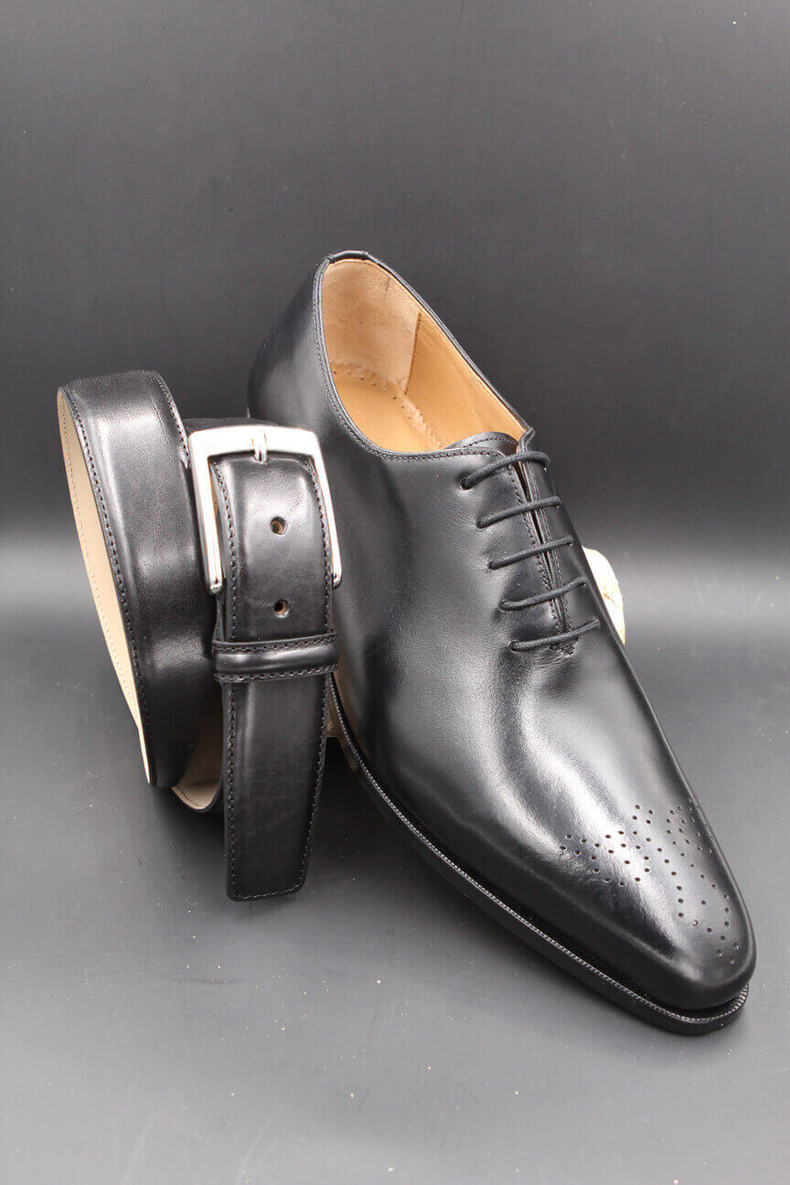 Black leather belt and black leather shoe